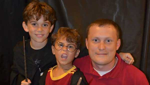 Simon Edwards, Hollis Edwards and Chad Edwards pose for a photo at last year's Harry Potter Party at the Greenville-Butler County Public Library. The Library hosts its 2nd Annual Harry Potter Party & Celebration next Tuesday.