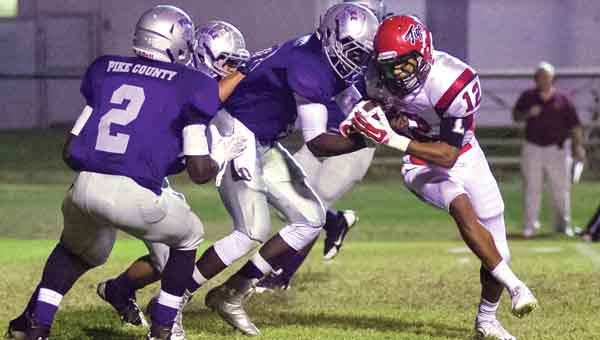 CONTRIBUTED PHOTO | JOEY MEREDITH  Junior Austin Bryant muscles through a pack of Bulldogs during Friday's game at Pike County High School.