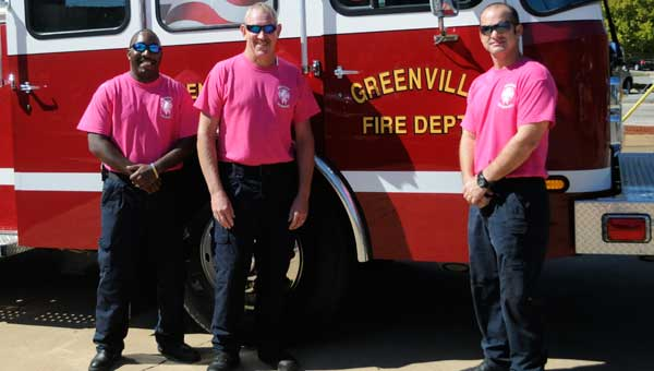 From left to right: Jolsie Griffin, Capt. Les Liller and Sgt. Micky Norman wear pink to raise awareness for breast cancer.