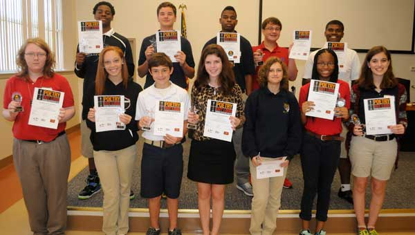 Twelve Butler County students will spend the next several months preparing for the regional phase of the National Poetry Out Loud competition, which will culminate in a final contest held in Washington in early 2015.  Pictured are: Georgiana School's Javares Thompson, Turner Vickery, Preston Hoffman and Demarcus Rich; McKenzie School's Caitlin Wingard, Dejanae Adams, Lauren Pierce and Isabella Holt; and Greenville High School's James French, Cordarius Longmire, Laun Pryor and Sellers Swann.