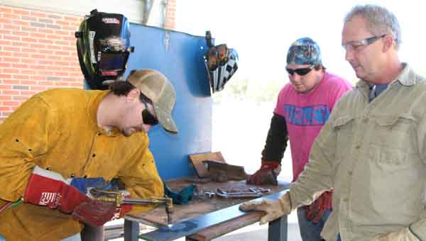 CONTRIBUTED PHOTO LBW Community College in Luverne offers welding classes for the first time, with Neal McGough of Highland Home, left, and Johnathan Mount of Luverne, center, participating fall semester. Also pictured is Mike Presley, welding faculty in Luverne.