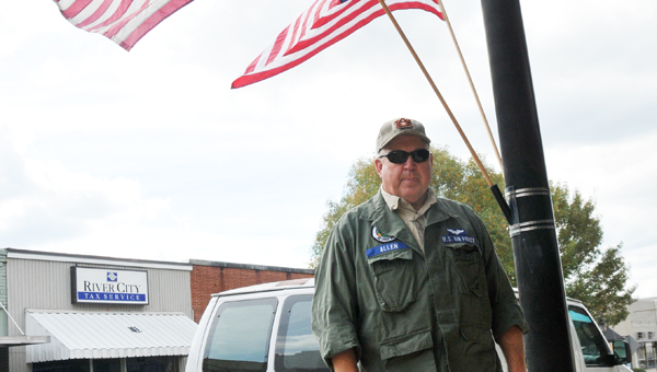 Retired U.S. Air Force Col. Buck Allen poses for a picture on East Commerce Street in downtown Greenville Tuesday afternoon. Yesterday, the nation honored veterans who have served or are serving in the armed forces for Veterans Day. | ADVOCATE STAFF / ANDREW GARNER