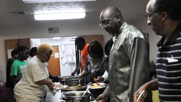 Members of the Pentecostal Church of Christ in Brantley serve seniors and their families at an annual Thanksgiving dinner. JOURNAL PHOTO | MONA MOORE