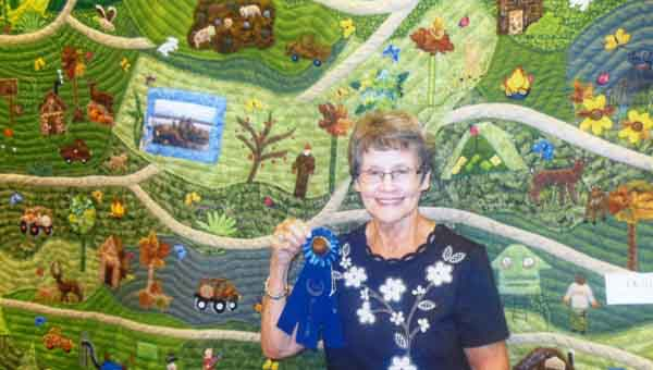 SUBMITTED Deloris Mount earned a blue ribbon for her quilt of a hunting scene.
