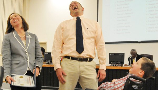 advocate staff / Andrew garner Butler County Schools Superintendent Amy Bryan (left) and Greenville Elementary School Principal Kent McNaughton react to Randall Van Cor's (far right) joke at Thursday night's meeting. | ADVOCATE STAFF / Andrew Garner