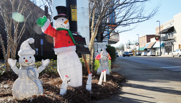 Frost the snowmen stand waiving to passers by Friday afternoon downtown Greenville on Commerce Street. Christmas Day is approaching fast. Night time viewing of this corner of downtown yields an excellent light display. | ADVOCATE STAFF / Andrew Garner