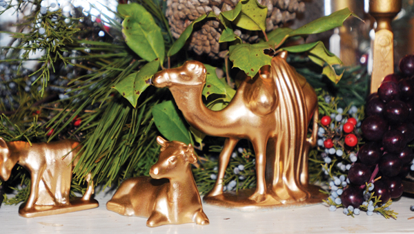 Above part of a nativity scene that is displayed on Tom Braxton's fireplace mantle. Right above the camel is a holly branch with thorns that represent the crown of Jesus at his crucifixion.   Tracy Salter / Advocate Staff