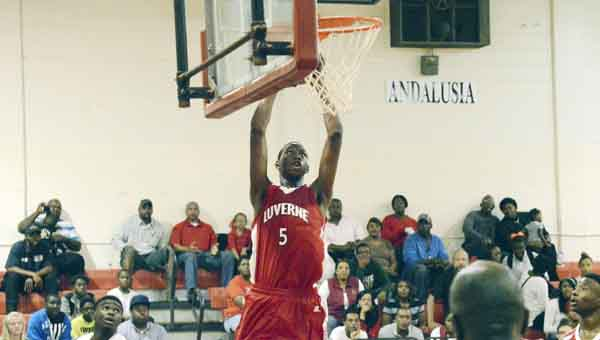 Luverne's Donta' Hall dunks the ball during Tuesday's game against Andalusia. JOURNAL PHOTO   JOSH DUTTON