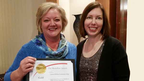 SUBMITTED PHOTO   LBW LBW Community College was recently recognized with Medallion Awards for writing, photography, and videos during the 2014 annual district two conference of the National Council for Marketing and Public Relations. Pictured are Renée LeMaire, left, representing LBWCC as NCMPR District 2 Council Director Kristen Holmes presents a gold award for writing, one of a total of 14 awards for the College.