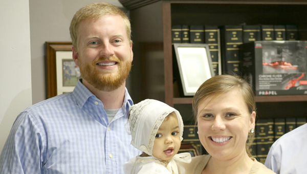submitted photo Alicia and Marty Sexton are shown here with Quinn at their adoption ceremony. | Courtesy photo