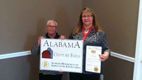 SUBMITTED  PHOTO  Dale Shepard (left) accepts the award from Amy Belcher on behalf of Mary Ann Harbin Faber.