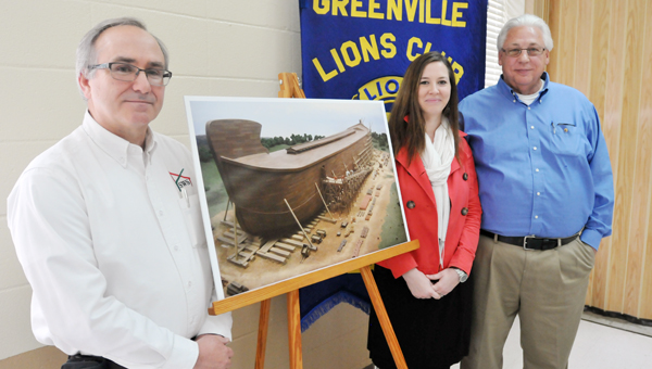 Shown from L to R: Ricky Taylor, Nicole Salter and Ricky Cargile pose for a picture next to a picture of Noah's ark. | ADVOCATE STAFF / ANDREW GARNER