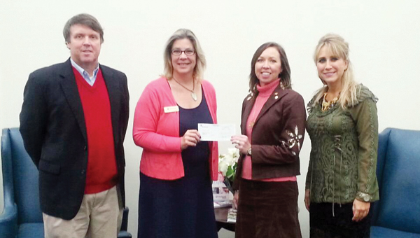Submitted photo |  Pictured left to right, Bill Lewis and Annette Cartwright of Trustmark Bank, and Amy Bryan and Tera Simmons of the Butler County School System.