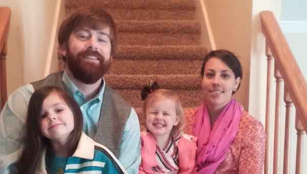 CONTRIBUTED  PHOTO Woody Money, pictured with his wife, Jessica, and daughters Madelyn, 5, and Ava, 2, writes about the balance he has found with family and his ministry since building an intimate relationship with God.