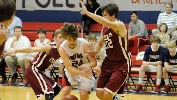 Escambia's Garrett Kirk made life difficult for the FDA, including Cody Parker, on the inside Tuesday night.  Despite an impressive comeback featuring a hail of late-game threes, the Eagles fell just short as the Cougars held on to win 60-55.