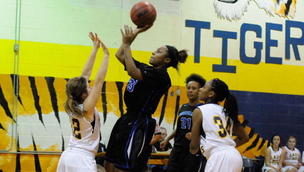 Georgiana lead scorer Tyanna Perkins elevates over a defender for a pair of her 23 points Thursday evening in Georgiana's runaway victory over its neighboring rival, the McKenzie Lady Tigers.