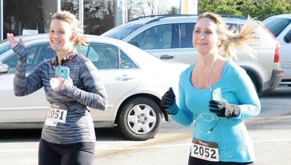 ADVOCATE STAFF / TRACY SALTER | Brandi Mosley and Tera Simmons are all smiles as they participate in the 10K race.