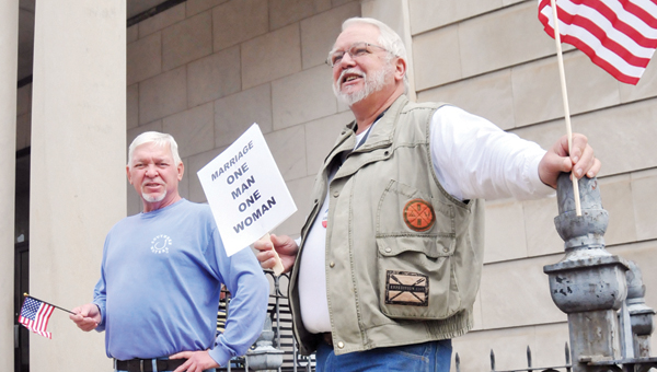 Concerned citizens Bobby Johnson (right) and John Langston stand outside the Butler County Courthouse in protest of the recent gay marriage ruling. | ADVOCATE STAFF / ANDREW GARNER