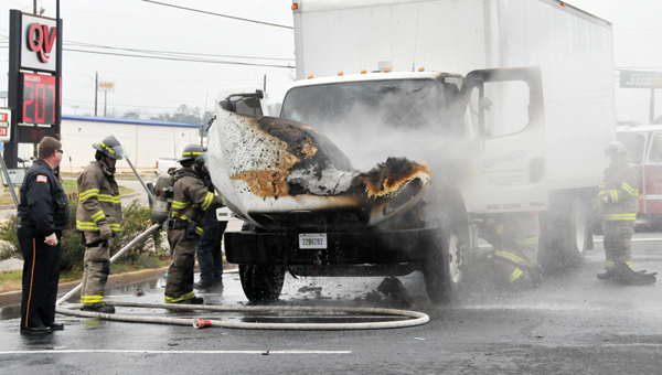 Engine trouble became much more troublesome Monday morning as a truck engine caught ablaze in the parking lot of the Texaco gas station next to I-65. | ADVOCATE STAFF / ANDREW GARNER
