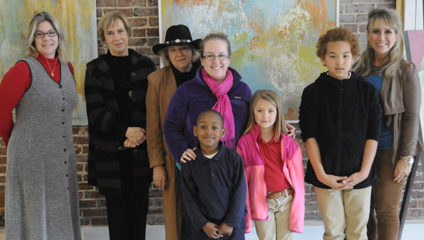 Kindergartener Micah Fail, first grader Kaylee McCann and sixth grader Marcus Fields were able to see their own artwork on display at the Capitol as well as the works of local artists at High Horse Gallery.  Behind the students, from left to right, are Trustmark representative Annette Cartwright, High Horse Gallery owner Mary McKinley, Faye Stokes, W.O. Parmer art teacher Ashley Sams and Tera Simmons. | ADVOCATE STAFF / JONATHAN BRYANT