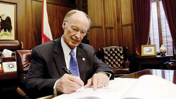 Gov. Robert Bentley signs a bill to allow charter schools in Alabama. Prior to the bill being signed into law, Alabama was one of eight states that did not allow public charter schools.