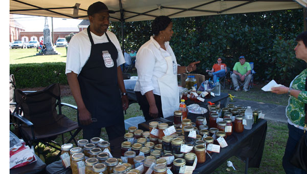 """""""Miss Teresa's Homemade Treats"""" vendors Clifford and Teresa Bullock share samples of their wares with CCF attendees."""