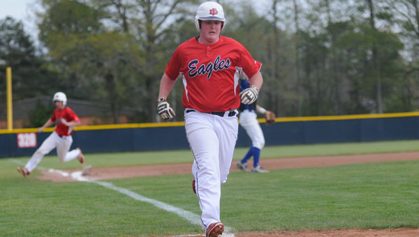 Evan Thomas sprints for home on a second-inning double for the Eagles' first run.