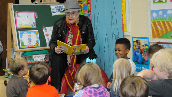 Longtime educator Bobbie Gamble captivated a small audience of children Monday morning with the aid of Dr. Seuss's most popular figure, The Cat in the Hat.