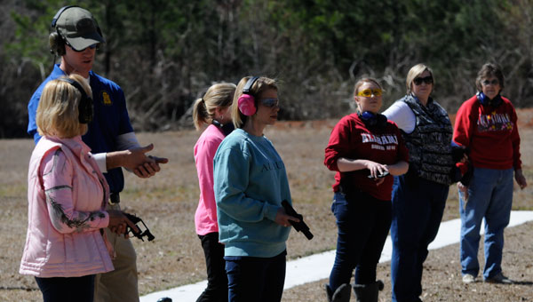 Greenville Police Department Captain Justin Lovvorn was one of several officers that helped 20 of the area's women become more familiar and comfortable with loading, firing and carrying various handguns.