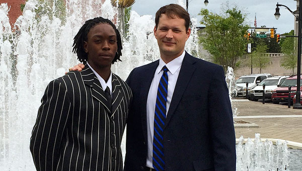 Junior Richard Boggan stands with Georgiana head basketball coach Kirk Norris.  Boggan's pinstripe attire made the shortlist for al.com's best dressed.