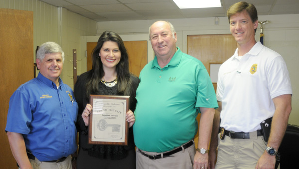 Alabama News Network's Catalina Trivino was presented the Key to the City  of Greenville Friday at the Greenville Police Department. She is pictured with, from left to right, Butler County Sheriff Kenny Harden, Greenville Police Chief Lonzo Ingram and Greenville Police Department Capt. Justin Lovvorn. (Advocate Staff/Andy Brown)