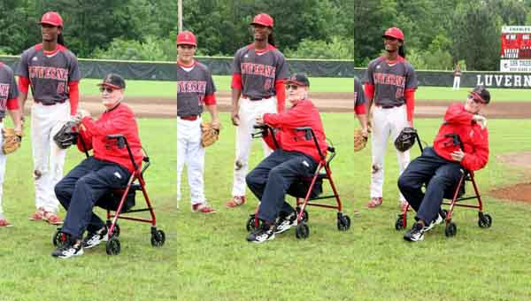 Retired coach Glenn Daniel throws out the first pitch at Saturday's playoff game. CONTRIBUTED | KIM SMILEY