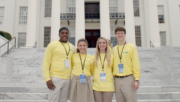 Four area high school students participated in the Alabama Rural Electric Association's (AREA) Youth Tour in Montgomery held on March 10-12.  Pictured left to right are Aderick Moore, Selma High School; Emiley Wells, Fort Dale Academy; Millie Motes, Lowndes Academy; Harrison Adams, John T. Morgan Academy on front of the Alabama State Capitol. (Courtesy Photo)