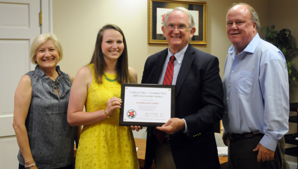 The Greenville Area Chamber of Commerce awarded its Camellia Girl and Chamber Page Scholarship on Monday night during the Greenville City Council meeting. Fort Dale Academy senior Kathryn McGowin and Greenville High School senior Shelby Sullivan each received a $500 scholarship.  Pictured are, from left to right, Francine Wasden, executive director of the Greenville Area Chamber of Commerce; Kathryn McGowin; Dr. Jim Krudop, president of the Greenville Area Chamber of Commerce; and Dexter McLendon, mayor of the City of Greenville. Not pictured is Shelby Sullivan who was unable to attend the meeting. (Advocate Staff/Andy Brown)