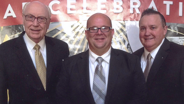 Jason Simmons, center, was recently ordained with the Assemblies of God at their 100th year district council service. Dr. George Wood, Assemblies of God general superintendent, and Rev. Kenneth Draughn, Assemblies of God Alabama district superintendent, presided over the ordination service. (Submitted Photo)