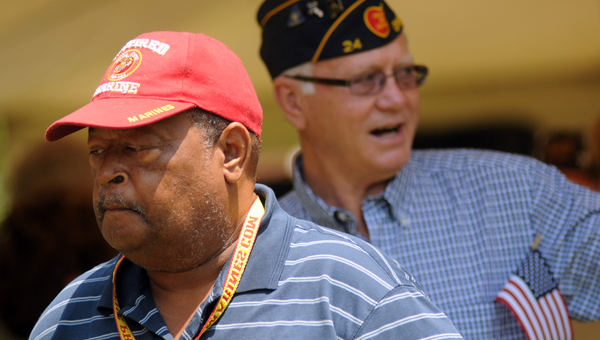 Veterans Rich Lewis, front, and Walter Parmer, back, take part in the Walk of Honor during last year's Memorial Day Celebration at Confederate Park. (File Photo)