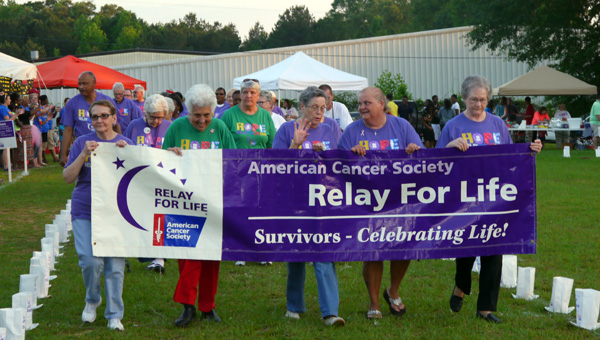 Cancer survivors Judy Rogers, Bennie Payne, Mary Agnes Hicks, Annette Merritt and Faye Gibson lead fellow survivors for the annual Survivors' Walk. (Photo by Angie Long)