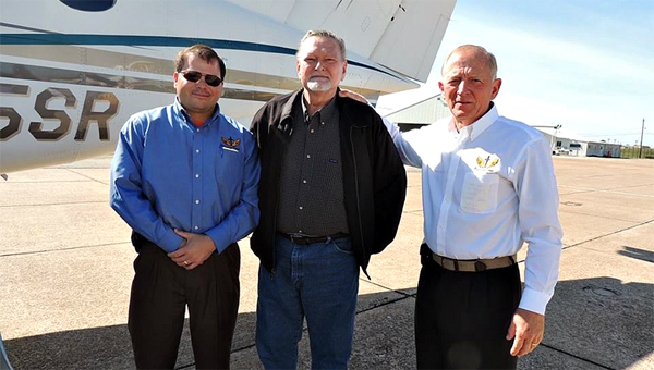 Floyd Atkins is seen flanked by Chris Smith and Harry Stinson, the PFC pilots who flew him free of charge to M.D. Anderson Cancer Center in Houston. (Submitted Photo)