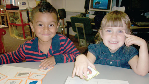 Butler County received $379,200 in grant funding for its voluntary pre-kindergarten program. Lyric Robinson and Janie Feralin work on letter sound and word matches at Greenville's Bright Beginnings. Both are graduates of the program. (File Photo)