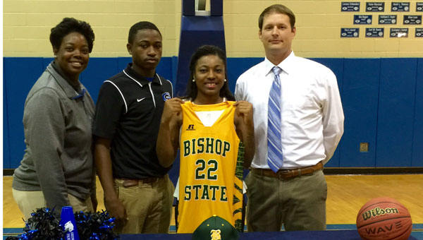 Lady Panthers senior captain and lead scorer Tyanna Perkins signed with Bishop State Community College Tuesday afternoon.  Standing with Perkins is assistant coach Lillie Boggan and Matt Campbell, as well head head basketball coach Kirk Norris.