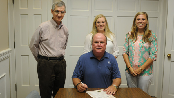 Greenville Mayor Dexter McLendon signed a proclamation Tuesday proclaiming June 15 as World Elder Abuse Awareness Day. On hand for the signing were, from left to right, Tom Nicholas, adult service social worker; April Lowery, Butler County DHR senior social work supervisor over adult services; and Alicia Sexton, adult service social worker. (Advocate Staff/Andy Brown)