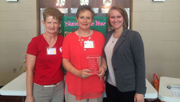 Butler County Schools Lead Nurse Debbie Hyatt was honored as the 2015 Registered School Nurse of the Year at the Alabama Association of School Nurses' 44th annual School Nurse Conference Thursday at Hewitt-Trussville High School. Pictured are, from left to right, Brenda Lindahl, Alabama Representative of the National Association of School Nurses, Debbie Hyatt and Beth Hyatt. (Courtesy Photo)