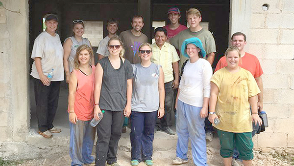 Twelve members of First United Methodist Church in Greenville recently set off on an international journey to Chemax, Mexico, to assist with Vacation Bible School and the construction of a community center. Pictured are, front row, left to right, Cailyn Thompson, Claire Davis, Kendall Hayes, Kathryn McGowan and Anne Blake Langford. Back row, left to right, Elizabeth Matthews, Stephanie Conner, Matt Langford, David Saliba, Pastor Gamaliel Hav Canche, Curt Davis, Warren Matthews and Connally Walters. (Courtesy Photo)