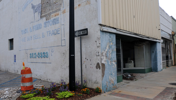City officials have announced plans to demolish the buildings at 208 and 206 West Commerce St. to make way for a new business. (Advocate Staff/Andy Brown)