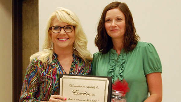 McKenzie School's Shawnee Pierce, right,  was inducted into the Jacksonville State University Teacher Hall of Fame on May 22. She was recognized for the honor at the Butler County Board of Education's meeting on Thursday night. She is pictured with Leta Norris. (Advocate Staff/Beth Hyatt)