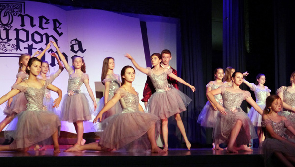 "The Red class, ages 11-14, perform a haunting ballet in the ""Beauty and the Beast"" segment of the show. Featured were: principal dancers Sydni Bowers, Lance Smith and Lilly Boswell along with Anna Cate Brack, Amaya Brogden, Riley Campbell, Hayden Fail, Xada Ingram, Mary Virginia Meadows, Kimball Nall, Ruth Anne Nimmer, Hannah Sells, Dailyn Swann, Laila Boutwell and Winsday Tetter. (Advocate Staff/Angie Long)"