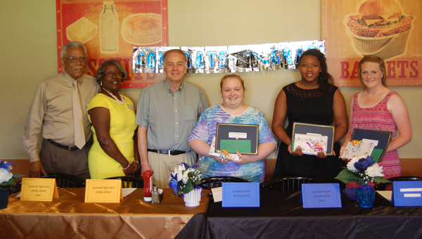 The Butler County Retired Educators Association presented three recent graduates with scholarships Tuesday at a luncheon held at Shoney's. Each year the organization presents a scholarship to one graduating senior from Greenville High School, Georgiana School and McKenzie School. Scholarships were awarded to Greenville High School's Shelby Sullivan, Georgiana School's Kennadee Smith and McKenzie School's Ashley Ballard. Pictured are, from left to right, Warren George, Alabama Education Retirees Association District 7 director; Pauline George, Alabama Education Retirees Association Area 2 East coordinator; Wayne Boswell, president of Butler County Retired Educators Association; Shelby Sullivan, Kennadee Smith and Ashley Ballard. (Photo by Rickey Burkett)
