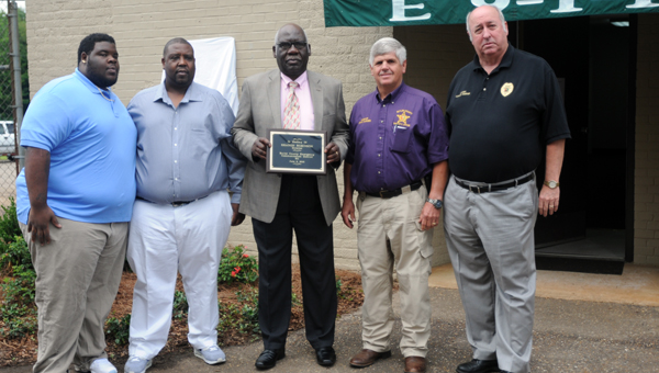 The Butler County E-911 building was renamed the Sharon Robinson E-911 Communications Center on Tuesday after former director Sharon Robinson. Pictured are, from left to right, LA Robinson, Edward Robinson, Jr., Edward Robinson Sr., Butler County Sheriff Kenny Harden and Greenville Police Chief Lonzo Ingram. (Advocate Staff/Andy Brown)