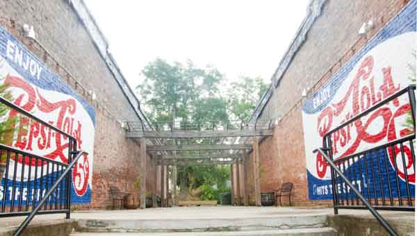 With new murals, seating, potted plants and a stage, downtown Luverne's Pepsi Pavilion is set for summer events. LUVERNE PHOTO | CHELSEA EYTEL