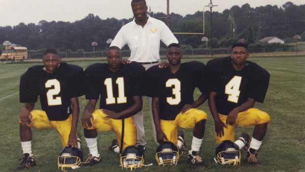 Sly Atkins, back row, stands with former players Harold Davison, Charles Jones, Eurosius Parker and Michael Feagin.